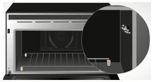 Remove food particles inside an oven as they can cause sparks due to carbonization.